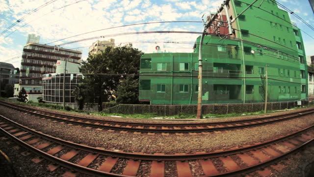 side pov, passenger train scenery. tokyo, japan - fish eye lens stock videos & royalty-free footage