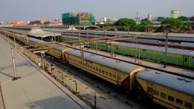 passenger trains are staged on the railway track at howrah railway station as the historic howrah bridge is seen in the backdrop, during nationwide... - howrah bridge stock videos & royalty-free footage