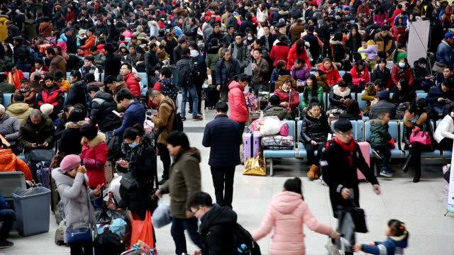 passenger transport around the chinese lunar new year,hangzhou long-distance west bus station,zhejiang,china - population explosion stock videos and b-roll footage