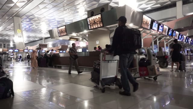 passenger walking at airport departure area - lobby stock videos & royalty-free footage