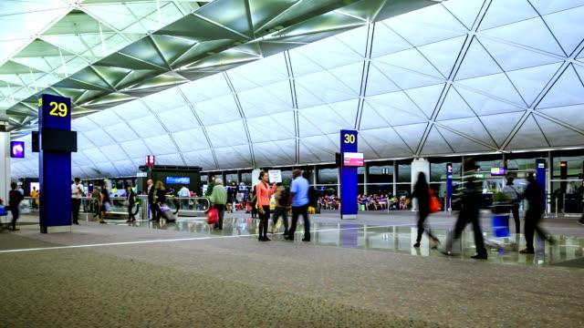 passenger walking in airport - hong kong international airport stock videos and b-roll footage