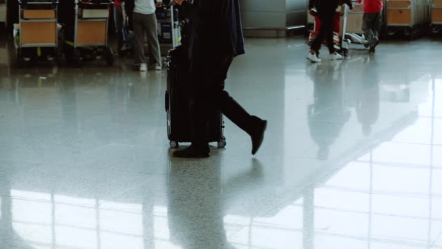 passenger walking in modern airport - slow motion - business travel stock videos & royalty-free footage