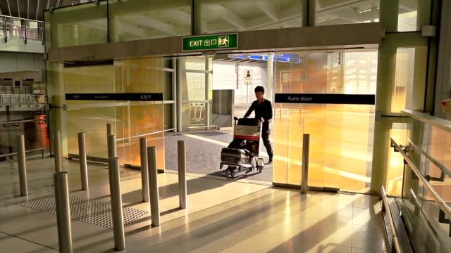 passenger walking in to airport - hong kong international airport stock videos & royalty-free footage