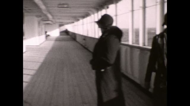 passenger walking on the promenade deck of the the white star line rms olympic, sister ship to the rms titanic. - passenger ship stock videos & royalty-free footage