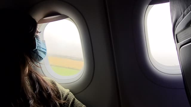 passenger wears a face mask at the plane takes off at flight transport during coronavirus on july 25, 2020 in luton, england - air vehicle stock videos & royalty-free footage