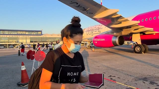 passenger wears a face mask on the runway as they transit to a plane at corfu airport at flight transport during coronavirus on july 29, 2020 in... - on the move stock videos & royalty-free footage