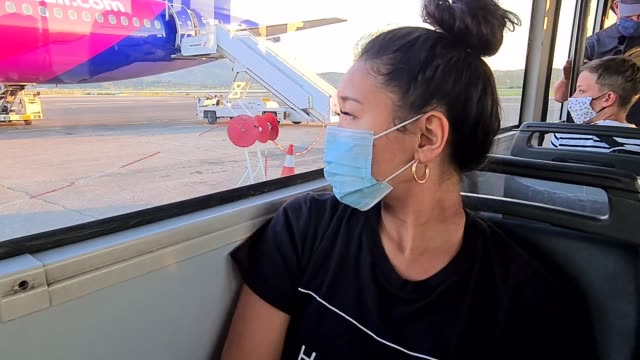 passenger wears a face mask on the runway as they transit to a plane at corfu airport at flight transport during coronavirus on july 29, 2020 in... - air vehicle stock videos & royalty-free footage