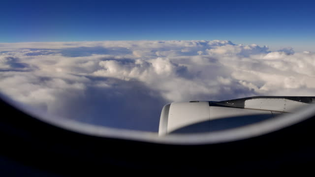 passenger window view in commercial airplane. travel journey scene background - window stock videos & royalty-free footage