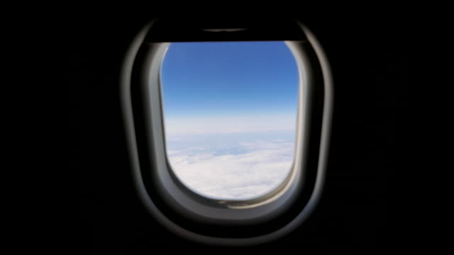 passenger window view in commercial airplane. travel journey scene background - fenster stock-videos und b-roll-filmmaterial