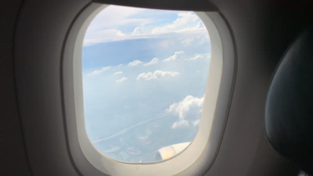 passenger window view in commercial airplane. travel journey scene background