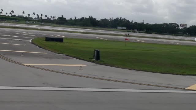 Passenger window view of commercial passenger jet takeoff with ambient sounds includes full rollout and liftoff with southern view of beach