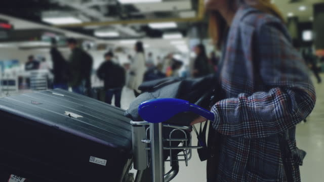 passenger with luggage standing on the line waiting at airport. - airport check in counter stock videos & royalty-free footage