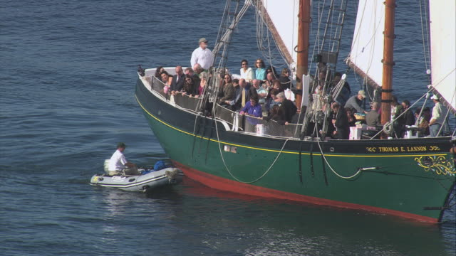 aerial passengers aboard the floating thomas e. lannon schooner / gloucester, massachusetts, united states - gloucester massachusetts stock videos & royalty-free footage