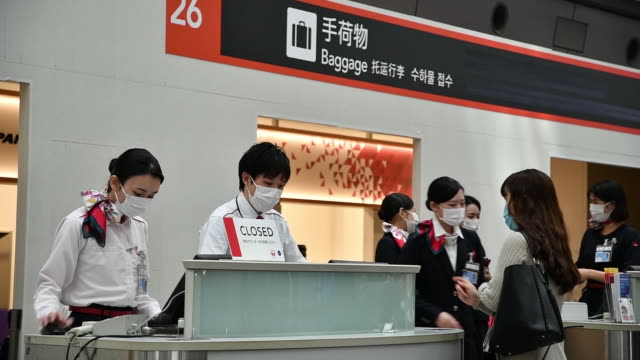 passengers and airport staff during covid19 pandemic at haneda airport in tokyo japan on thursday april 23 2020 - japan bloomberg stock videos & royalty-free footage