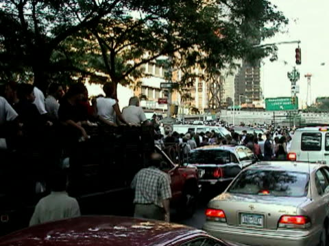 passengers and cars waiting in traffic at entrance to queensboro bridge during citywide blackout on august 14, 2003 / new york, new york, usa / audio - 2003 stock videos & royalty-free footage