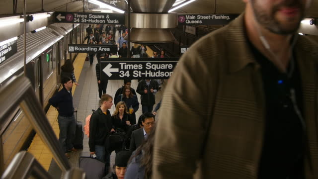 passengers and new york subway train station - new york city subway stock videos & royalty-free footage