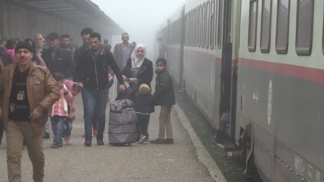 passengers are seen at a railway station in fallujah, iraq on december 23, 2018. the fallujah-baghdad rail service back on track after a four-year... - al fallujah video stock e b–roll