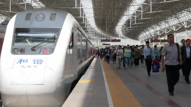 Passengers arrive at Beijing train station in China