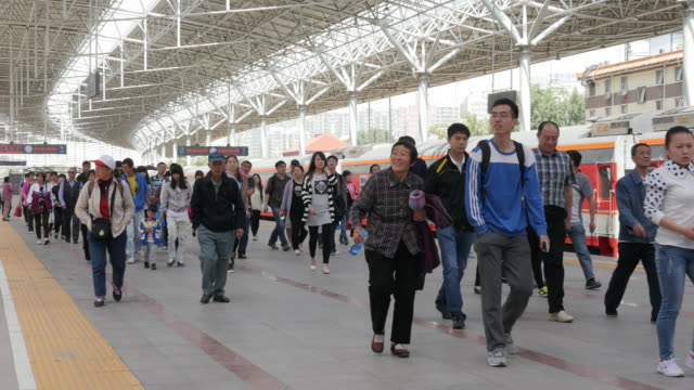 passengers arrive at beijing train station in china - station stock-videos und b-roll-filmmaterial