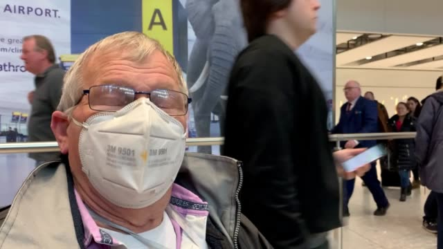 passengers arrive at heathrow airport in london after the last british airways flight from china touched down in the uk barrington bryan and joe speak - coronavirus stock videos & royalty-free footage
