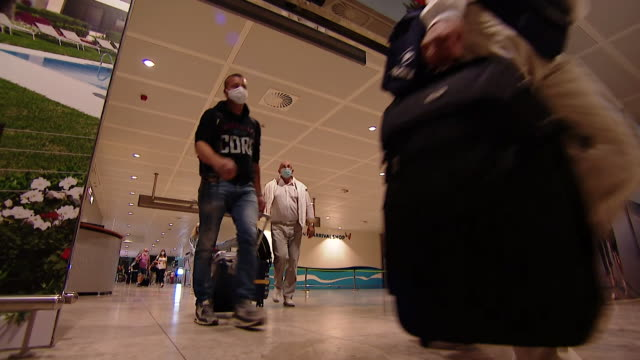 passengers arriving at airport in alicante from the uk as spain reopens its tourism sector after coronavirus lockdown - public celebratory event stock videos & royalty-free footage