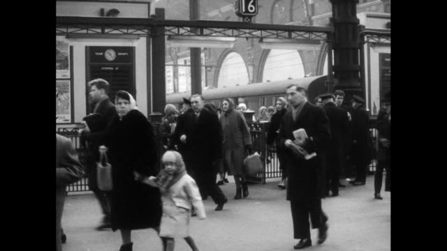 b&w passengers arriving at uk train station; 1963 - archival stock videos & royalty-free footage
