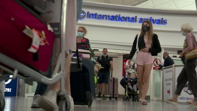 passengers arriving back from spain at stansted airport, as uk government impose two week quarantine on anyone travelling back from spain during... - reportage stock videos & royalty-free footage