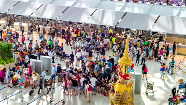 Passengers at Airport Check In Counter,High Angle View