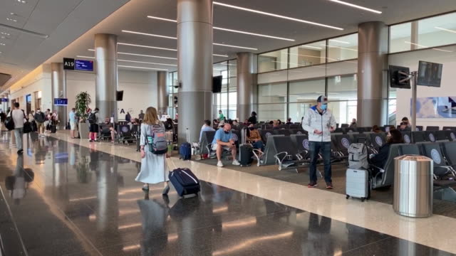 passengers at airport terminal waiting area on opening day of the salt lake city international airport in salt lake city utah us on tuesday september... - flugpassagier stock-videos und b-roll-filmmaterial
