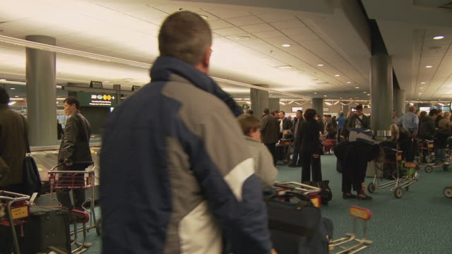 WS Passengers at baggage claim in airport / Vancouver, British Columbia, Canada