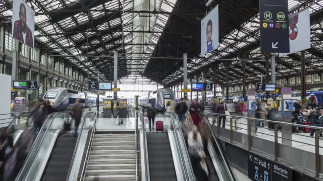 passengers at gare de lyon in paris, france. - poster stock videos and b-roll footage