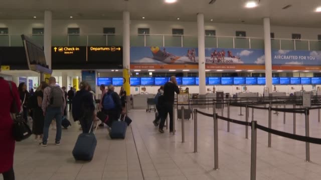 passengers at gatwick airport are greeted by an announcement that the thomas cook airlines company has ceased trading and all flights are cancelled... - failure stock videos & royalty-free footage