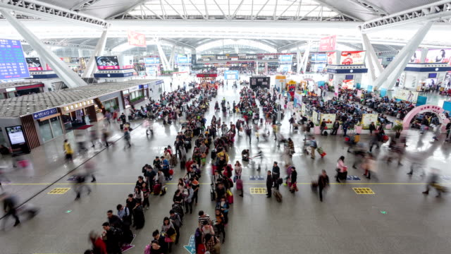 t/l ws passengers at highspeed railway station / guangzhou, china - transportation event stock videos and b-roll footage