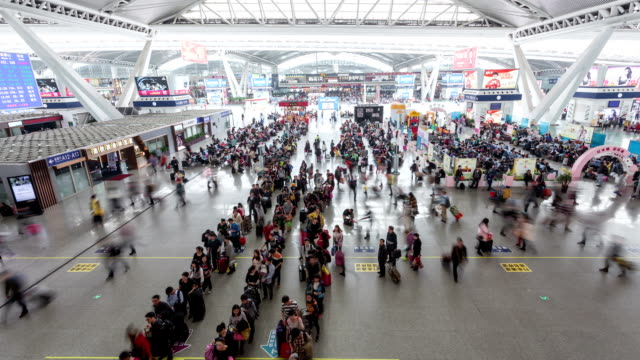t/l ws tu passengers at highspeed railway station / guangzhou, china - transportation event stock videos and b-roll footage