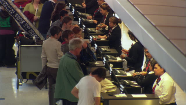 ms, ha, passengers at los angeles airport check in desk, los angeles international airport, los angeles, california, usa - airline check in attendant stock videos & royalty-free footage