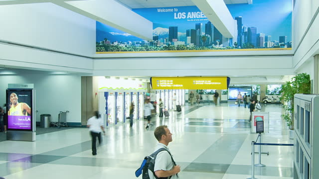 ws t/l passengers at los angeles international airport / los angeles, california, usa - 広告点の映像素材/bロール