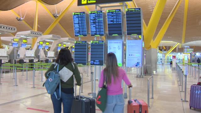 passengers at madrid barajas airport during the reopen to european and schengen area tourists. also alllows free movement of spain citicens after the... - tourism stock videos & royalty-free footage