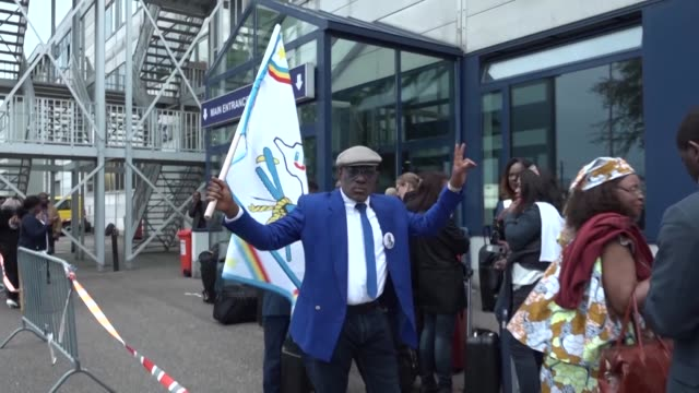 passengers at the airport in brussels react after the repatriation of the body of former congolese prime minister and opposition leader etienne... - former stock videos and b-roll footage