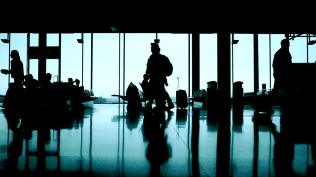 passengers at the terminal airport - in silhouette stock videos & royalty-free footage