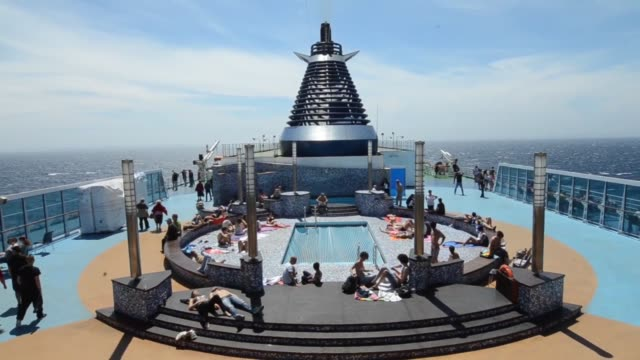 passengers attend a party on the deck of the cruise barcelona passenger ship operated by grimaldi compagnia di navigazione spa as it travels to... - ponte di una nave video stock e b–roll
