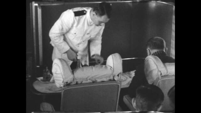 passengers being served food during flight on a short empire 'c' class flying boat. - luxury stock videos & royalty-free footage
