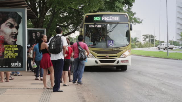 ls passengers board a bus in brasilia / brasilia, brazil - bus stop stock videos & royalty-free footage