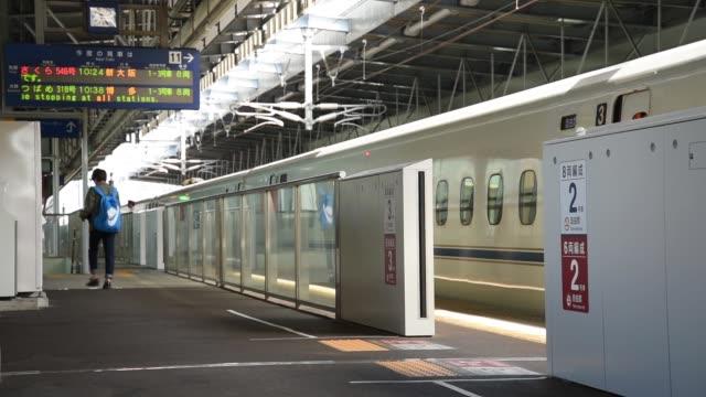 passengers board a kyushu railway co 800 series shinksnsen bullet train at kurume station in kurume city fukuoka prefecture japan on tuesday oct 11... - kyushu railway stock videos & royalty-free footage