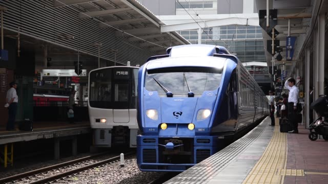 passengers board a kyushu railway co. 883 series sonic limited express train at hakata station in fukuoka city, fukuoka prefecture, japan, on... - kyushu railway stock videos & royalty-free footage
