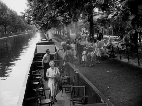 passengers board a narrow boat for a tour along london's grand union canal 1951 - narrow stock videos & royalty-free footage