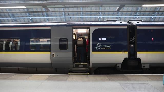 Passengers board a train operated by Eurostar International Ltd at St Pancras International railway station in London UK on Thursday Jan 18...