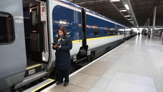 Passengers board a train operated by Eurostar International Ltd at St Pancras International railway station in London UK on Thursday Jan 18 A member...