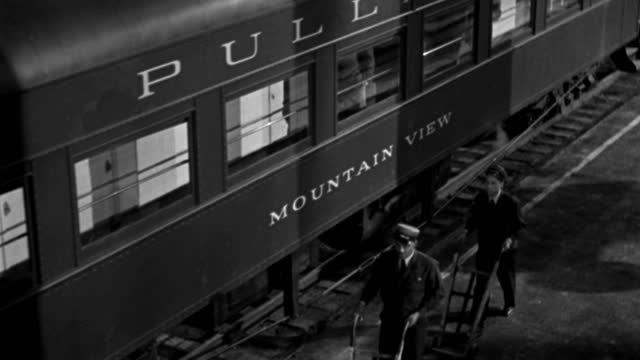 passengers board a train, two porters prepare for departure and the train departs. - 1946 stock videos & royalty-free footage