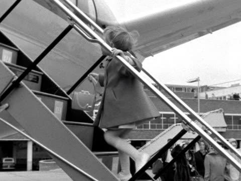 passengers board an aircraft at london airport. - human age stock videos & royalty-free footage
