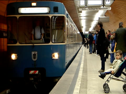 passengers board and alight u-bahn tube train munich - land vehicle stock videos & royalty-free footage